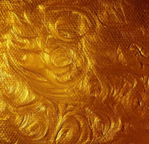 acrylic-gold-paint-swirl-stock