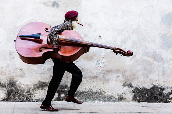 Cuban_Man_with_Large_Moustache_Walking_with_Double_Bass