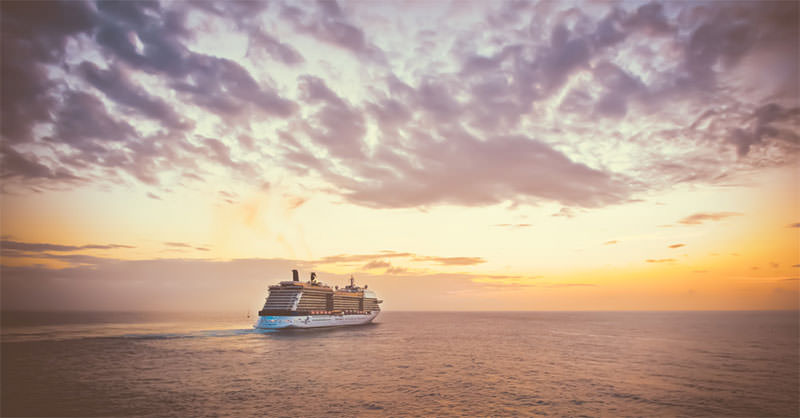 Cruise-Ship-Sailing-Into-A-Colorful-Sunset