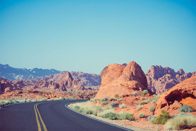Dramatic-Road-Between-Red-Rocks-In-The-Desert1