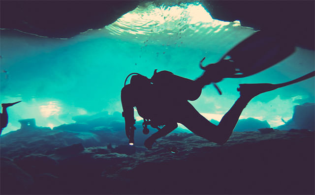 SCUBA-Diver-In-Blue-Water-Silhouette