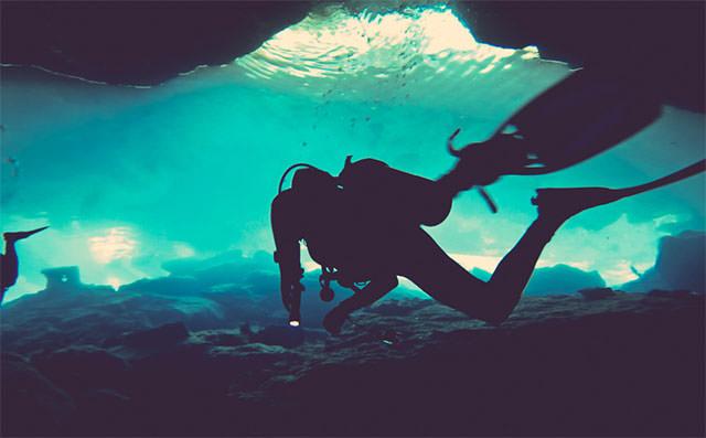 SCUBA-Diver-In-Blue-Water-Silhouette