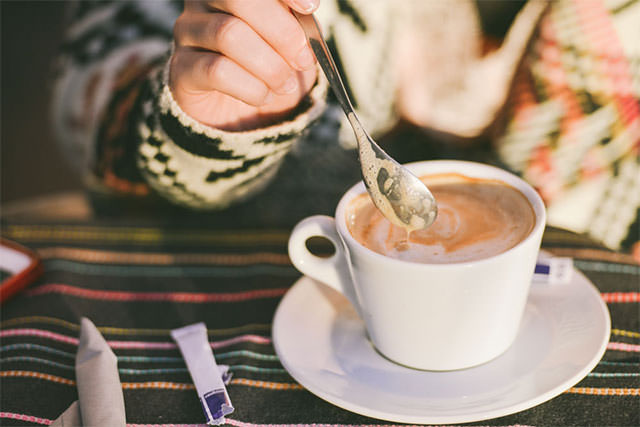 Woman-Stirring-Capuccino-Coffee